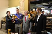 Sarah and Raphael Perrier, owners of Kahwa, with Tampa Mayor Bob Buckhorn and pitchman Anthony Sullivan.