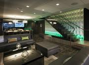 Johnson said the stadium also features lounges like the one pictured here. It is lit with green for the New York Jets home game, but the colors change to blue for the New York Giants.
