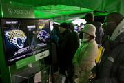 Fans play Microsoft XBox games while visiting Super Bowl Boulevard.