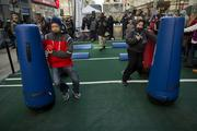 Fans run an obstacle course on Super Bowl Boulevard.