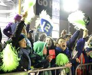 Delta employees and their families cheer as the chartered Delta flight with the Super Bowl Champion Seattle Seahawks unloads at Sea-Tac Airport.