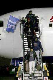 The Super Bowl Champion Seattle Seahawks exit a chartered Delta flight at Sea-Tac Airport.
