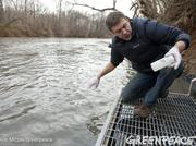 Matt Wasson, director of programs at Appalachian Voices, collects water samples from the Dan River to test for heavy metals on Feb. 4. Duke Energy (NYSE:DUK) said up to 82,000 tons of coal ash and 27 million gallons of water were released from a pond at its retired power plant in Eden, N.C., into the river. Duke the spill was caused by a 48-inch stormwater pipe beneath the unlined ash pond that broke Feb. 2, draining water and ash from the 27-acre pond. See more images of the spill in this slideshow.