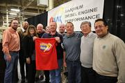 (L-R) IUE Servicing Rep Matt Clark; IUE Local 755 President Carl Kennebrew; Manufacturing Manager Christine Sitek; IUE President Jim Clark – Willie Thorpe; District 7 Director - Ken Ream; IUE Local 755 Shop Chairman Jason Chambers (holding shirt); 755 Committeeman Jon Hutchinson; 755 Committeeman Donny Goings; Isuzu President and COO Maho Mitsuya and Plant Manager Fred Tijerina.