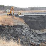 Duke Energy reaches break in pipe at coal ash pond