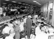 Customers pack in Dorothy Lane Market at its grand opening of the new store on Far Hills Avenue in 1953.
