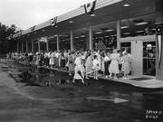 Customers anxiously await the grand opening of Dorothy Lane Market after it moved to Far Hills Avenue in 1953.