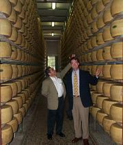 Todd Templin, director of wine, beer and cheese sales for DLM, checks out stacks of Parmigiano Reggiano in Monteveglio, Italy.