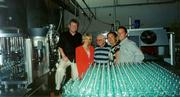 Norman Mayne and others in the DLM team pose in the bottling plant for DLM's line of Vera Jane extra virgin olive oil in Monte San Savino, Italy.