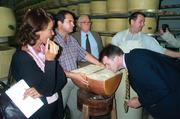 Todd Templin, director of wine, beer and cheese sales for DLM, makes sure a block of Parmigiano Reggiano passes the sniff test.