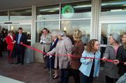 Norman Mayne holds the ribbon as his mother Vera Mayne cuts it at the opening of the Springboro store in 2002.