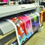 Thompson Print & Mailing still pressing envelope — and more