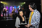Glenn Anderson, right, owner of Hawaiian Brian's, talks with Sinai Davis, manager for the band Chaotic Five, about the rundown for a concert at Hawaiian Brian's. Anderson and Sinai coordinated to produce a concert fundraiser to help raise money for Typhoon Haiyan relief. while giving the Chaotic Five band an opportunity to perform and also give back to the charity of their choice. The band, whose members range in age from 10 to 14 years old, plays classic rock music from the 1970s.