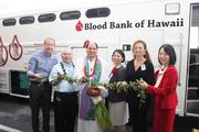 Blood Bank of Hawaii staff and board members attended a blessing ceremony and inaugural drive for the nonprofit's new bloodmobile, which completes the first phase of a community-supported fundraising effort. From left, Markus Staib, trustee; Albert Yoza, chief financial officer; Kahu Kordell Kekoa; Dr. Kim-Anh Nguyen, president and CEO; Lori McCarney, chair of the board; and Lori Kaneshige, director of collections.