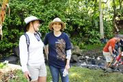 Laura Lott, left, director of community and public relations and Janet Liang, president of Kaiser Permanente Hawaii, at the Papahana Kualoa in Kaneohe where they helped to restore and maintain the loi patches as well as the stream.