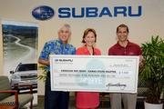"Subaru Hawaii's ""Share the Love"" sales event raised $7,500 for the American Red Cross – Hawaii State Chapter by donating $250 for every new vehicle sold by Subaru Hawaii dealers from Nov. 1 to Dec. 31, 2013. From left, Glenn Inouye, Servco Automotive senior vice president; Coralie Matayoshi, American Red Cross-Hawaii State Chapter CEO; Jason Pizarro, Servco Subaru sales consultant."