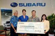 "Subaru Hawaii's ""Share the Love"" sales event raised $7,500 for Big Brothers Big Sisters Hawaii by donating $250 for every new vehicle sold by Subaru Hawaii dealers from Nov. 1 to Dec. 31, 2013. From left, Glenn Inouye, Servco Automotive senior vice president; Holly Brown, Big Brothers Big Sisters Hawaii director of development and marketing; Dennis Brown, Big Brothers Big Sisters Hawaii CEO; and Dorinda Shimazu, Servco Subaru sales consultant."