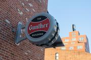 The Gunther Apartments include four-story-high beer tanks along exposed brick corridors.