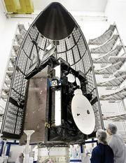 An Advanced Extremely High Frequency communications satellite is seen in an Atlas V rocket's payload fairing, or cover. (File photo)