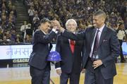 Mayor Kevin Johnson, right, celebrates with Kings majority owner Vivek Ranadivé, left, and NBA commissioner David Stern.