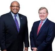 J. Gordon Cooney (right) of Morgan Lewis & Bockius  with CEO  Bryan Carter of   the Gesu School of Philadelphia.