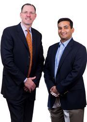 Marc R. Lederman (left) of  NewSpring Capital with LiquidHub CEO Jonathan Brassington.