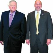 George MacKenzie (left) of the formerly Hercules Inc. with Jeff Sterba, CEO of American Water Works.