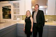 Designer April Spagnolo, left, and Co-Owner Paul Podgorski of Design & Development are pictured at Distinctly U Kitchen & Bath Design Center & Showroom for the Trends & Friends Social Networking Event, held Jan. 17.