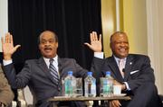 Montgomery County Executive Isiah Leggett, left, jokes around on stage with Prince George's County Executive Rushern Baker.
