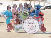 A lifelike mile marker by Gietl Sign Co. featured the Cullen family from left: Colleen, Gael, Annie, Cullen, Molly, Kathleen and Myles.