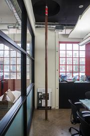 The old firepole still remains in the conference room at Marian Develpoment Group.