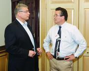 David Kristian, left, of Premier Power Solutions, LLC and Daniel Adley of KTA -Tator, Inc.