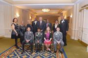 """Dominion Virginia Power and the Library of Virginia came together to celebrate the leadership and accomplishments of eight African Americans during the second annual """"Strong Men & Women in Virginia History"""" awards program. The event was held Feb. 5 at the Richmond Marriott.   Top row, from left, Kimberly Wilson, the great-great niece of posthumous honoree John Mitchell, honoree Olivia Ferguson McQueen, Sheila Coates of Women United for Action representing posthumous honoree Elizabeth Keckly, honoree Judge James R. Spencer, Virginia Gov. Terry McAuliffe, honoree Alexandria Mayor William Euille, honoree Dr. Mary Futrell and honoree Marcellus """"Boo"""" Williams. Bottom row, from left, eastern region essay winner Garrett Jones of Greenbrier Christian Academy, central region essay winner Jocelyn Lee of Franklin Military Academy, northern region essay winner Lexi Maycock of West Springfield High School, and western region essay winner Tyler Phillips or Ashby High School. Not pictured: Barbara Sookins-Goode of J. H. Blackwell Elementary School who represented honoree James Blackwell."""