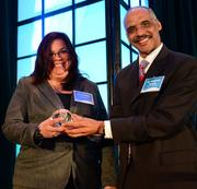 Lisa Rushin with Fulton County accepted the Healthiest employer award from Reginald Mason with Kaiser Permanente.