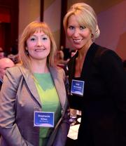 Stephanie Killen with AGL Resources and Carla McCormick with Fallon Benefits.