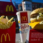 McDonald's sheds stores and gains customers with budget appeal