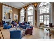 The main level has high ceilings and large windows offering panoramic lake views.