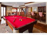 The lower level of the home has a recreation room and a bar.
