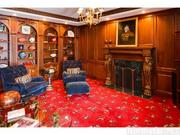 The home has eight fireplaces, including one in the walnut-paneled study.