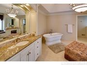 The home has six bathrooms, including three full, two three-quarter-baths and a half-bathroom.