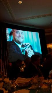 A photo of 40 Under 40 winner Michael Kleber is displayed on the screen.