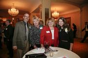 A group with 40 Under 40 winner Courtney Carlson (at right) of Waukesha County Technical College
