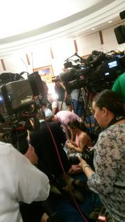 The media throng as Brewer made the announcement.