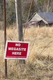 "Members of the Northeast Randolph Property Owners Association have placed ""No Megasite Here"" signs across the county."