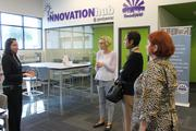 Neetu Rao (far left), program manager for ASU's entrepreneurship and innovation group out of ASU SkySong, is discussing resources available at the Innovationhub@GoodyearAZ with Erin MacFarlane, branch manager for the Goodyear Library and Shirley Robertson, communications coordinator for Estrella Community Services and Glady.