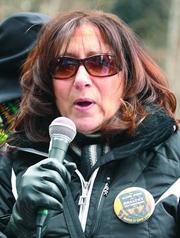 Sue Delozier, a registered nurse at UPMC Altoona, addresses the crowd.
