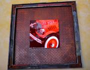 Red photographs in rusted metal frames. They take their ambiance literally at Cafe Red.