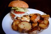 The Cajun chicken club features a sauce with a little kick and is served with Cafe Red's own Fatty Fries.