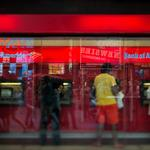 Bank of America swings to $514 million loss as mortgage-related legal woes take toll