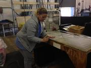 Amanda Leady, secondary operator, deburrs and smooths thermoformed acrylic parts in the plastics plant